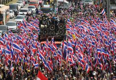 Anti-government protesters hold Thai flags as they march towards the Department of Special Investigation (DSI) in Bangkok.