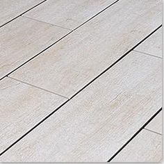 Hard to believe this is a ceramic floor.  Love this and it's dirt cheap! Salerno Porcelain Rustic Woodgrain Alpine Ash.