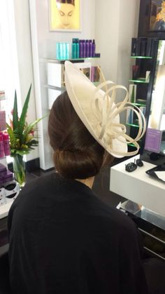 Updo with fascinator