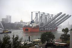 Boskalis vessel Teal transports four new ship-to-shore cranes up the Savannah River past historic River Street to Garden City Terminal at the Port of Savannah, Monday, Dec. 5, 2016. (Georgia Ports Authority/Stephen B. Morton)