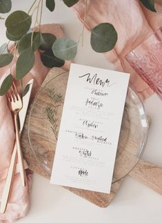 Featuring beautifully quirky watercolor calligraphy, this rectangular black-and-white menu is modern in its simplicity.