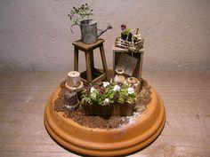 Garden scene on a pot saucer