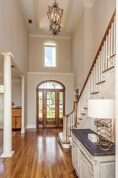 High ceilings & stunning fixtures are a match made in foyer heaven in this Ocean Springs, MS home!