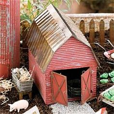 A rustic metal barn completes any fairy garden farm setting. Note: Does not include any accessories or silo, barn only. Note: The door on this house opens