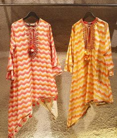 Beautiful Tunics with asymmetric cut and detailing with dori-latkan and embellished with tassels. Bright prints in leheriya style and western cuts tunic gives traditional feelings. saved by Cotton Kurties, Printed Cotton, Cute Baby Girl Outfits, Kids Outfits, Embroidery Suits, Hand Embroidery, Dress Paterns, Simple Kurta Designs, Indian Wear