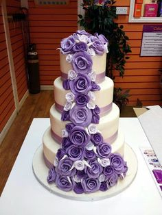Purple rose tiered wedding cake