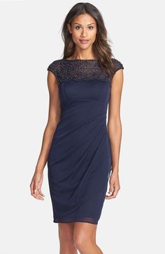 Free shipping and returns on Xscape Beaded Jersey Sheath Dress at Nordstrom.com. Glinting gunmetal beads illuminate the mesh cap-sleeve yoke atop this airy matte-jersey dress. Designed to flatter your every curve, the Empire-waist style is gathered to one side with a cascading panel and ruching down the center back.