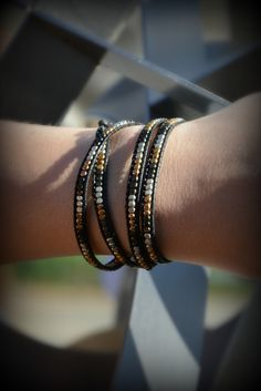 Here's a bracelet that works with any style, our Fair Trade Metallic Wrap Bracelet. Ethically sourced black leather cording borders glass beads in gold, silver & gunmetal, you can pair this fair trade