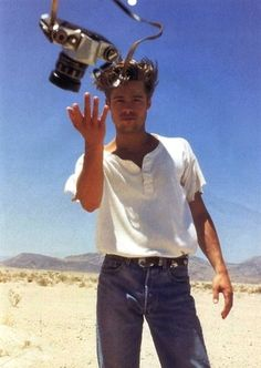 Brad Pitt throwing a camera