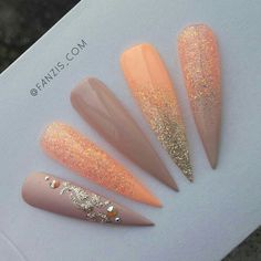 Lovely peach and gold nails.