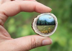 tiny needle felted landscape on deer antler slice - just really cool - by Lisa of Lil Fish Studios -