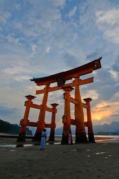 Tori gate at Itsukushima shrine in Hiroshima Japan