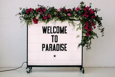 Light Box Sign & Floral Garland | Aloha Tropical Wedding inspiration | Wedding ideas | Rebecca Goddard Photography | http://www.rockmywedding.co.uk/tropics-in-the-city/