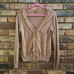 **Buy One, Get TWO FREE** Tan cardigan Selling a beige, button down cardigan with ruffle trim along the front. I love the buttons! Great condition!  Buy one, get two free!! Merona Sweaters Cardigans