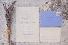 Classic calligraphy in pale lavender blue ink on creamy paper with rounded corners. Photo: Stephanie Kapra