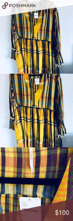 Free people oversized plaid mini dress Oversized plaid mini dress featuring a flowy skirt  ..Bodice and sleeves are featured in soft cotton ..v-Neckline  ..wide long sleeve with adjustable ties ...hip pockets  Machine wash cold Free People Dresses Mini