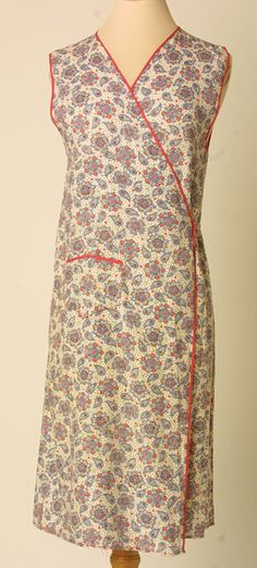 """Housecoat, made by Hercules, England: 1930-1935, floral-printed cotton. Woven Label Center Back Neck: """"The Beech Tree brand, a guaranteed garment"""""""