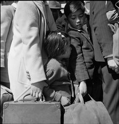 Third-generation American children of Japanese ancestry in Byron, Calif., awaiting the arrival of the bus that would take them from their homes to an internment center.  (US National Archives: Dorothea Lange)