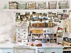 I love the storage ideas in this vintage styled work space, especially the old metal baskets.
