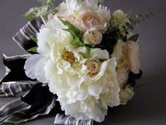 Artificial silk flower wedding bouquet. White peonies,dusty pink and creamy ranunculus,spray roses queen Anne's lace,,black raspberries, Design by Simone Vartan.