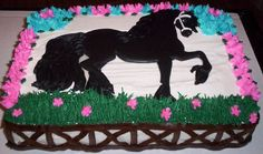 I made this cake for my daughter who is turning 8. She is in riding lessons and loves horses. For her birthday they are going horse back riding. The cake is a 1/4 sheet filled with bavarian cream. Iced with extra special buttercream. The horse is a royal icing transfer.
