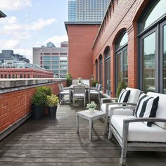 """The Great Outdoors - Explore Gwyneth Paltrow's Goop-Worthy Tribeca Penthouse - Outdoor Balcony sittling area ... Nice place to """"dream"""" and relax"""