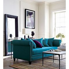 Love the sofa placement - it creates a walkway behind and fantastic interest and storage with the use of the mirror reflecting a sofa table and accessories. Very unique idea