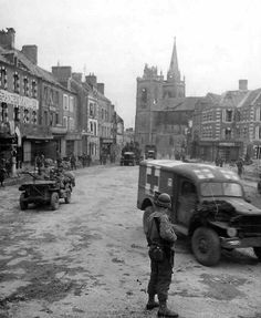 US Jeeps and Dodge WC Ambulance in the Streets of La Haye-du-Puits