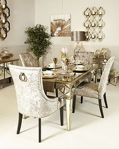 Our Sahara Gold Mirrored Furniture range features gold Mirrored Furniture pieces inspired by the ornate glitz of Morocco and brings a sumptuous feel with an ethnic retro flourish. Mirror Dining Table, Luxury Dining Tables, Dining Room Table Decor, Dining Table Design, Living Room Decor, Dining Rooms, Mirrored Furniture, Home Decor Furniture, Hamptons Living Room