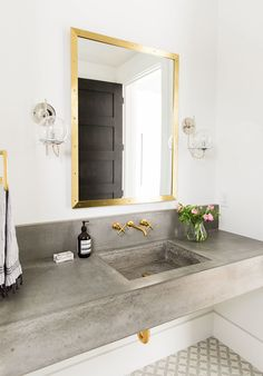 White & Gray bathroom, cement floating slab sink, gold accents, gray & white ceramic tile