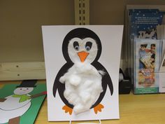 Penguin made from construction paper and cotton balls.