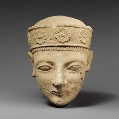 Limestone head of a beardless male with a diadem. Culture: Cypriot