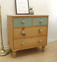 The combination of antique pine and duck egg blue paint works beautifully