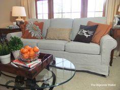 Custom slipcover updates this sleeper sofa in rustic, heavy weight linen.