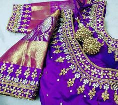 Beautiful hand embroidered blouse in blue shade with gold combintion.Latkans in gold are attractive. Kids Blouse Designs, Hand Work Blouse Design, Simple Blouse Designs, Stylish Blouse Design, Wedding Saree Blouse Designs, Pattu Saree Blouse Designs, Blouse Designs Silk, Lehenga Saree Design, Maggam Works