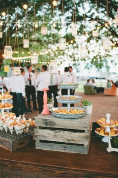 rustic wedding dessert display with mini doughnuts and mini bundt cakes.