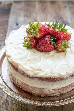 This lovely and easy Strawberry Layer Cake is made in a jiffy and has the best cream cheese frosting! It's a summer dessert staple!