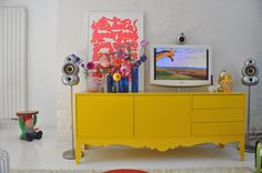 Striking yellow console, beautiful. Gnome side table, delightful.
