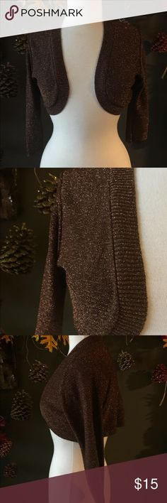 Bronze metallic crop sweater jacket Cute bolero style sweater in a beautiful bronze metallic. That little something Ito wear over an evening dress that won't take away from the dress or just adds to a spaghetti strap dress or top. Unlined Sweaters