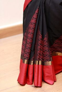 Red print on black Kanchi Cotton saree