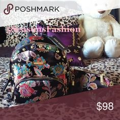 💋STEVE MADDEN Brocade Backpack & Wristlet Floral BRAND NEW WITH TAGS! 🔥Hot FALL 2017 TREND🔥 BROCADE backpack bag from Steve Madden with matching wristlet 2PC SET😻😻😻 Floral embroidered design over jet black satin like material. Stylish GOLD TONE STUDDED zip around style bag with tassel. FAUX LEATHER DETAIL and straps. Large exterior zip pocket. Wristlet features zipper closure and outside slip pocket. Steve Madden SIGNATURE liner. MUST HAVE FOR ANY FASHIONISTA! Size small/medium…