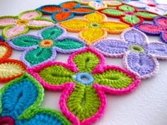 Free Pattern for Crochet Hawaiian Flower Motif: The pattern is actually splattered on four web pages (annoying) but if you just click to each one, you could copy/paste into a word document (which is what I did) to have them all on one place...The flowers alone, not so cool, but all together, as a blankie, FABOO!