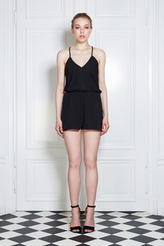 Time to play in this smooth little playsuit. Sharp V-neck with beautifully braided straps crossed in back. Elastic waistband. Double layers to reduce transparency.Oh, and did we mention that it kicks ass?