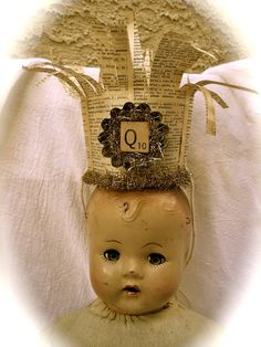 Queen. - I love these old dolls and the addition of the crown is a sweet bonus.