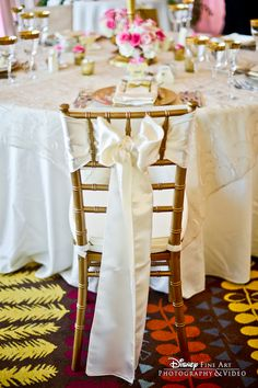 There's nothing we love more than an elegant chiavari chair, except if it's accented with a luxurious sash! #Disney #wedding #decor #chiavari #chair