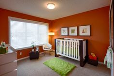 Orange gives the small contemporary nursery a more cheerful look - Decoist Striped Nursery, Orange Nursery, Bright Nursery, Bright Paint Colors, Nursery Paint Colors, Baby Room Colors, Baby Nursery Furniture, Baby Nursery Decor, Nursery Ideas