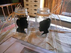 Beautiful silhouettes painted on mason jars painted by artist Nikki Schuitema and designed specially for Bilancia Designs weddings.