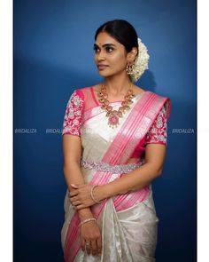 In a bridal look in pink & silver color pattu / kanjeevaram saree, short sleeve blouse design, hip chain, necklace and jewelry Wedding Saree Blouse Designs, Pattu Saree Blouse Designs, Half Saree Designs, Blouse Designs Silk, Blouse Patterns, Saree With Belt, Simple Blouse Designs, Saree Trends, Saree Models