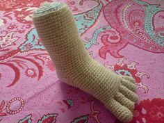 foot to display baby shoes, booties or socks