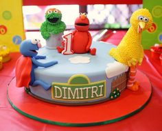 "@Sheila Fox this is EXACTLY what I'm planning on doing for Ellie's cake, except with figurine characters instead of fondant, Abby and cookie monster instead of Oscar & Grover, and it will say ""Happy 2nd Birthday"" on top :)"